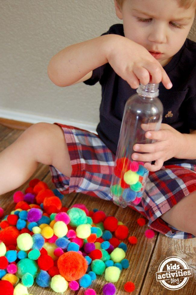 fine-motor-play-with-a-pompom-bottle-2